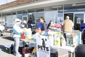 Pet food and supplies were distributed by volunteers.